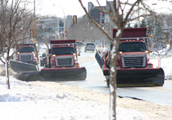 snow plows plowing snow three in a row