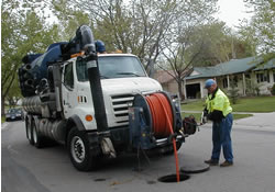 vactor truck with sewer worker working catch basin